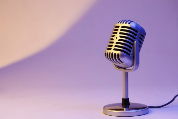 retro microphone isolated on color background