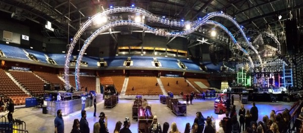 """""""The crew gets set up for the show. You can see the giant rails for Tommy's drum set to fly over the crowd."""""""